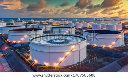 Storage of chemical products like oil, petrol, gas, Aerial view oil storage tank terminal and tanker, petrol industrial zone, Business commercial trade fuel and energy transport by tanker vessel. Stok fotoğraf ©