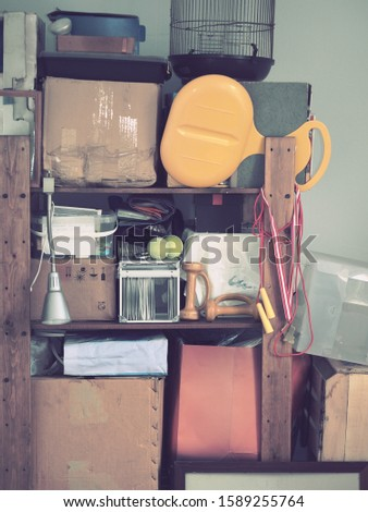 Storage of old, old-fashioned things from the past, props for filming on racks in boxes.