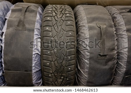 Storage of old winter tires in specialized covers