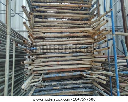 Attirant Storage Of Scaffolding Parts In Construction Area #1049597588