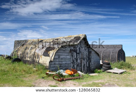 Storage sheds made from upturned boat hulls. (Holy Island, England.)