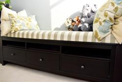 Storage solutions in window bench in living room or bedroom