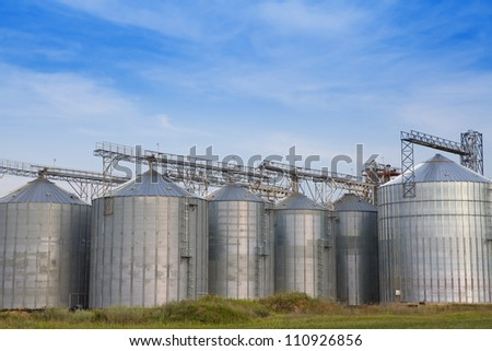 Storage tanks for grain and oil products - stock photo