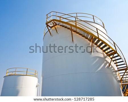 storage tanks in oil refinery plant with blue sky