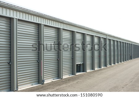 Storage units at a storage facility with one door partially open.