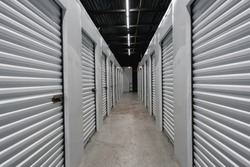 Storage warehouse interior. Metal garage doors with locks
