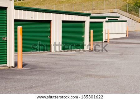 storage warehouse units with room for text on the doors or on the pavement.
