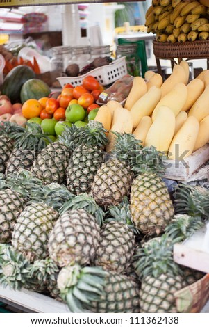 Store fruits are pineapple, mango, orange and watermelon. Market sales.