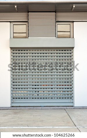 Store is closed. Metallic roll shutter door of commercial retail store.