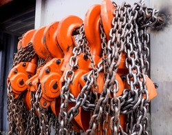 Store of chain block and shackles inside container door panel.