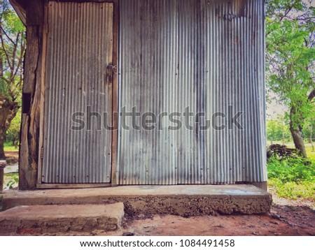 Store room made by old zinc wall with old cement floor