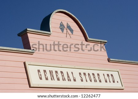 store sign - commercial sign on a pink house