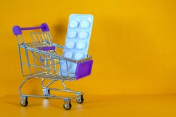 store trolley, Pills, medicines, protective equipment, medical goods. Concept Shortage of medical supplies. Concept Demand, sales growth for medicines and protective equipment.