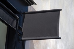 Storefront kakemono Mockup. Black Shop sign on a wall in street template