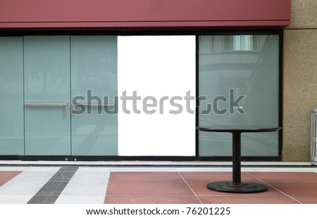 Storefront of an empty store with blank sign to be completed by customer - stock photo