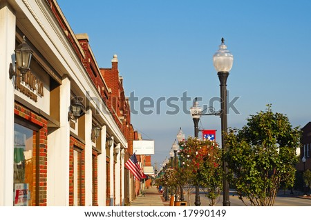 Storefronts, sidewalks, and lamp posts in small-town America