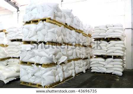 storehouse with stacked sacks of meal