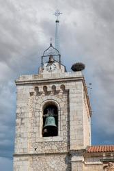 Stork's nest in a church steeple in Roa de Duero, Spain