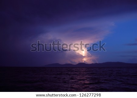 Storm and Lightning over and island and sea