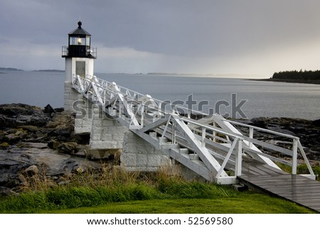 Storm approaching historic Marshall Point Lighthouse, Maine, USA