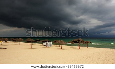 Storm approaching over a tropical beach