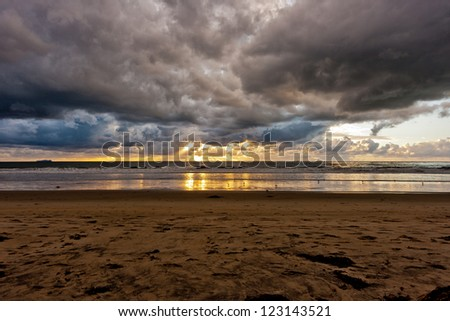 Storm clouds and Sunset at Silver Strand State Beach in Coronado, California - stock photo