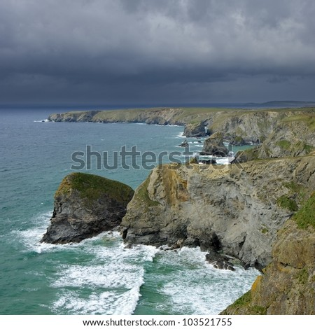 Storm clouds brewing over Bedruthan Steps near Newquay North Cornwall.
