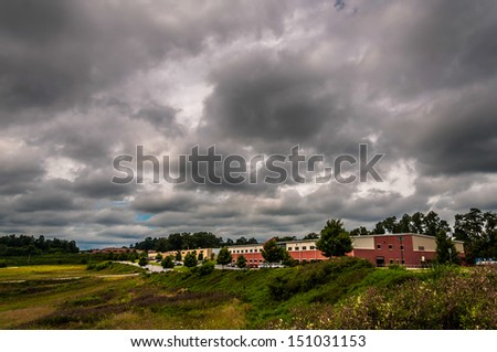Storm clouds over buildings in an industrial park in York County, Pennsylvania.