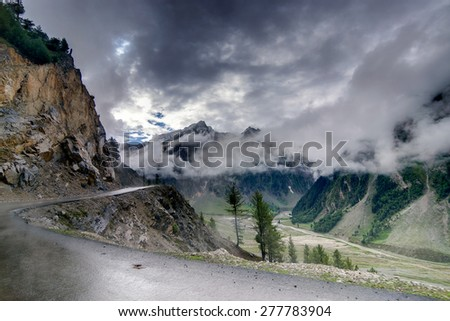 storm clouds over mountains of ladakh, green valley sccenary,  Jammu and Kashmir, India