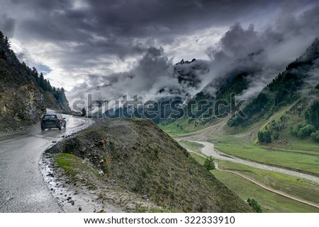 storm clouds over mountains of ladakh, green valley scenery,  Jammu and Kashmir, India