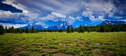 Storm clouds over the Grand Teton mountain range.