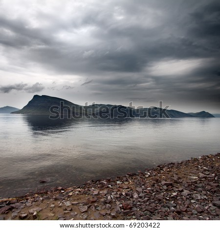 Storm clouds over the island in sea