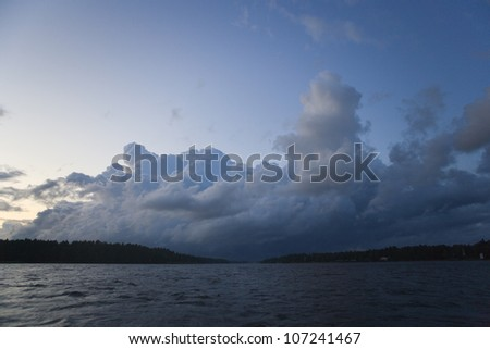 Storm clouds over Vanern lake at dusk