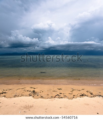 Storm clouds rising in tropical sand beach nusa lembongan bali indonesia