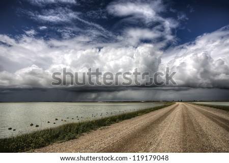 Storm Clouds Saskatchewan billowing clouds and gravel road