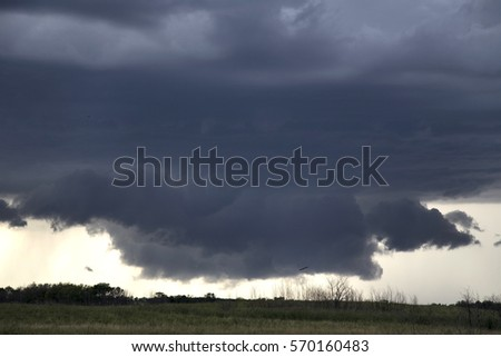 Storm Clouds Saskatchewan Prairie scene Canada Farm #570160483