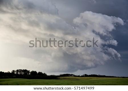 Storm Clouds Saskatchewan Prairie scene Canada Farm #571497499