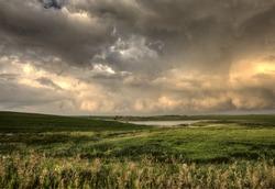 Storm Clouds Saskatchewan sunset over prairie field