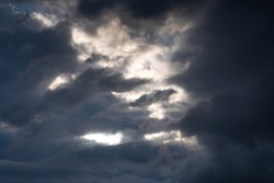 Storm clouds. The sky before a thunderstorm. Rays of the sun through dark thunderclouds