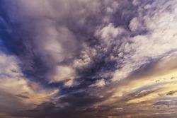 Storm cloudscape at sunset