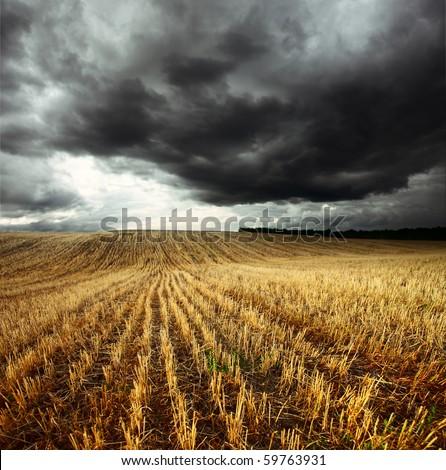 storm dark clouds over field...