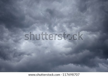 Storm deep blue sky with light patch in the center