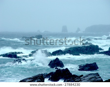 Storm in Newfoundland Ocean with waves crashing over rocks