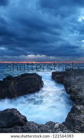 Storm in sea bay and dark sky.