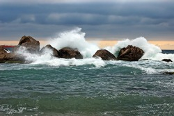 Storm in sea, beside the wild rock