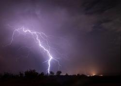 storm lightning over fields of spain