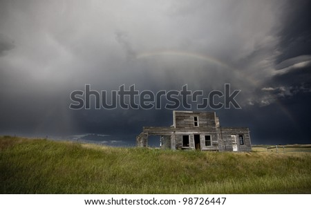 Storm over abandoned farm house in Saskatchewan Canada