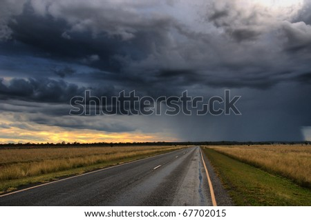 storm over an Outback highway in Central Queensland, Australia