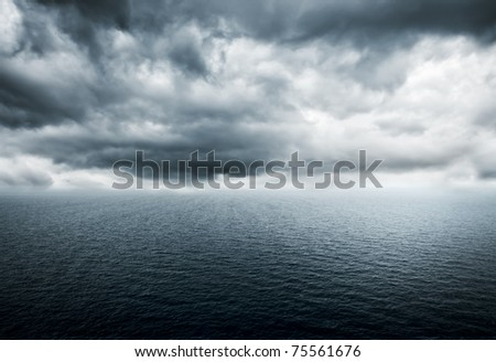 Storm over the ocean - stock photo