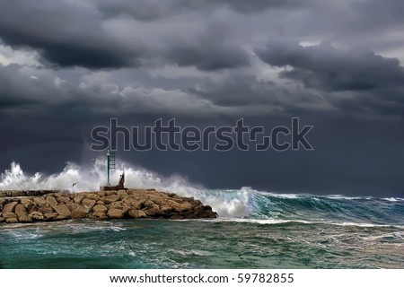 Storm, pier and small beacon